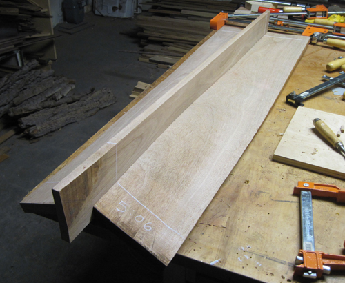 bottom of bench seat showing the sag and twist of the matched boards