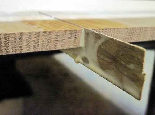 Filler strip glued in place.