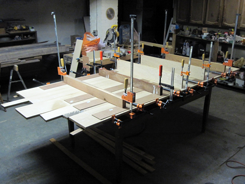 final glue-up of the top, which is composed of seven quarter-sawn white oak boards.